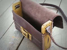 https://www.etsy.com/listing/213873202/hand-sewn-unique-handmade-leather-wood