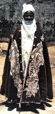 Africa   Hausa royalty, wearing an elaborately embroidered cape.   ©unknown
