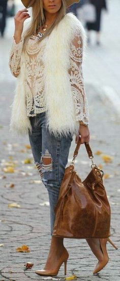 Lace top, and faux fur vest. It does go well together