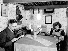 Leeds WWII -Mr and Mrs Fawcett pictured in their well-designed air raid shelter in the garden of their home in Cardigan Avenue, Leeds. The local Air Raid Precautions volunteers praised the Fawcetts' shelter, which even had electric lighting © Leeds Library Service