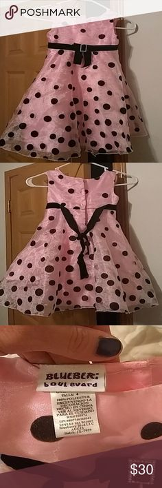 BEAUTIFUL classic youth girls pink & black dress Beautiful throw back to the 50's youth girls pink with shimmering black polka dots that has an A-line slight poof. My little girl wore this and about brought me to tears with how clean and classy it looks on someone so young. To be honest at first I thought it would look a little too over the top  but actually when worn this dress made her look like a timeless classic. Not too much not too little absolutely PERFECT! And wearable to any…