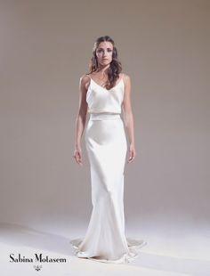 The Elsa dress – Sabina Motasem. A slip-style bias cut, backless, slinky satin wedding dress with spaghetti straps worn with a lace bodice.  www.motasem.co.uk #biascutweddingdress