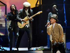 Nile Rogers and Pharrell Williams team up at the Brit Awards at 02 Arena on Wednesday in London.