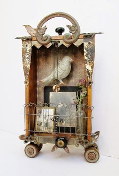 """This is my newest assemblage art shadowbox....it has little places to hang jewelry and is perfect for photos or collectibles. Now available in my ETSY shop (""""SassytrashAntiques"""")"""
