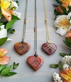First of all, I'm feelin' the burnt, end-of-summer oranges and reds of these Wrapped Jasper & Aventurine Hearts! 🧡 These necklaces are new… Wire Wrapped Necklace, Wire Wrapped Pendant, Wire Wrapped Stones, Wire Jewelry Designs, Jewelry Crafts, Copper Jewelry, Beaded Jewelry, Jewlery, Stone Wrapping