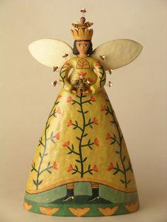 Ceramic sculpture by Lisa Smith of Santa Fe. Bee Queen