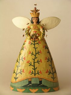 Ceramic sculpture by Lisa Smith of Santa Fe. Bee Queen