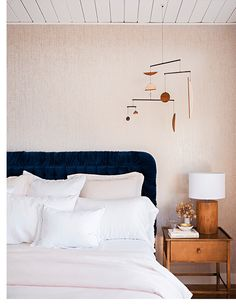 Always one to have a little fun while still keeping things simple, Emily Henderson placed an eye-catching mobile in the bedroom of her previous home for some added personality, as featured in Domino.