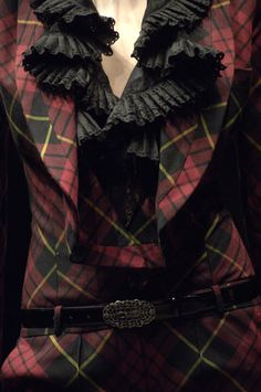 """Widows of Culloden""fall/winter 2006/07 ~ jumpsuit of McQueen tartan; ruffled shirt of black cotton with broderie anglaise."