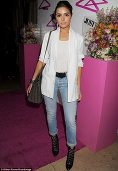 Casual customer: Olivia Culpo looked good in a white jacket over a white top tucked into l...