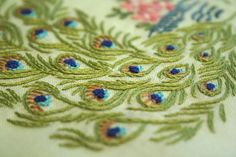 Pretty embroidered peacock feathers