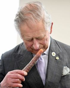 Prince Charles was seen giving a purple carrot a very close inspection during a visit to F...