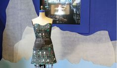 """This animated dress form, created by Lisa Hoffman and called """"Underneath,"""" was also part of the 2nd Skin: Imaginative Designs in Digital & Analog Clothing exhibit at the Exploratorium in San Francisco. Made from computer circuit boards, the mannequin-like creation interacts with the audience by turning to face whoever is standing closest to it. Adding another medium to the work of art, a microphone, mounted under the dress, amplifies the sound of the stiff Tyvek material as it moves."""