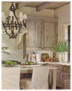 Kitchen: Tile built in look of range hood - shelf across range on back splash, ceiling