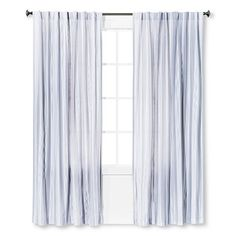 Sheer Curtain In The Front And Blackout Drapery Behind