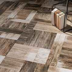 """The combination of #shades and their drawn graphic movements on long and narrow sizes, designed a dynamic game of """"light and dark"""": here's #Pictart by #CeramicaSantAgostino.  #design #designtiles #tiles #archilovers #contract #style #modern #contemporary #mood #project #designlovers #wood #woodlook #designtiles"""