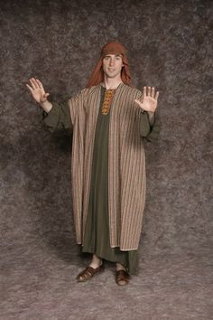 $20.00 Nativity Man #2 olive long tunic w/detail at neck, rust striped long vest, rust headpiece w/olive detail