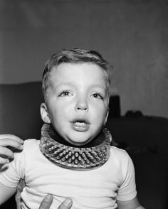"Neck Cleaner  ""Five-year-old Tim Gregory wears, under protest, a brush that cleans a child's neck without the use of soap and water in Los Angeles, Calif., Jan. 12, 1950. The plastic collar brush will dry-clean the youngster's neck thoroughly as he plays. The brush was developed by the Los Angeles Brush Corp. at a mother's suggestion.""    What ever happened to a good old fashioned bath?"
