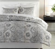 An exotic medallion printed in tonal grays on our smooth sateen brings a sumptuous feel to your bed. Add a mix of textured accent pillows to complete the look. Linen Comforter, Ways To Sleep, Neutral Bedding, Furniture Slipcovers, Outdoor Furniture, Gray Bedroom, Master Bedroom, Bed Duvet Covers, Comforters