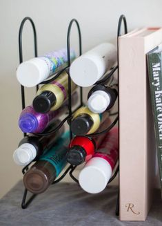 Use a wine rack to store hair products -- 17 Genius Makeup Organizing Hacks That Will Save You From Chaos - SELF