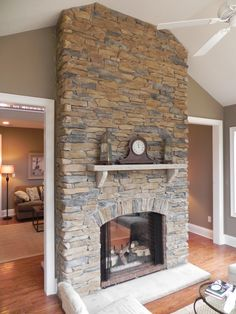 Floor to ceiling stone fireplace divides rooms. Maybe in the addition with a 2 sided fireplace!!!