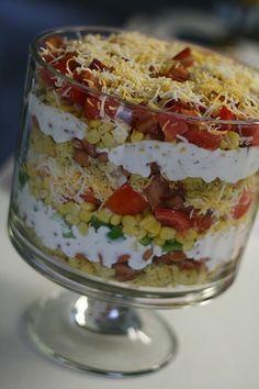 layered cornbread salad in trifle bowl