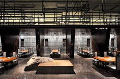 separated dining areas underneath mezzanine.  Haneda, a beautiful restaurant serving Japanese food in the city of Fuzhou. The amazing restaurant interiors are the work of Kris Lin of the Hong Kong-based firm Kris Lin Interior Design.