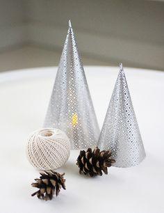 Make a striking + modern metal cone lantern. DIY by AMM blog.
