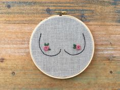 Because all boobs are beautiful, unique, and bloom with femininity and purpose. And lets just say it - LOVE not having that bra on all day! - 6 hoop - Oatmeal linen fabric - Muave pink floss NOTE: The back of the hoop is unfinished - meaning the back shows the not-so-pretty part of stitching. Not