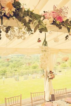 Hanging top table arrangements from www.inspire-hire.co.uk