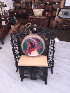 Brimfield sept show 2016 corner of Christibys booth with Adirondack stool and twig lattice fireplace screen from Dick Cavette estate