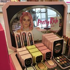 """Have cosmetics will travel with this Too Faced Pretty Rich Suitcase Display. Open it presents an array of merchandise and forward facing """"Pretty Rich"""". Suitcase Display, Jukebox, Presents, Retail, Pretty, Face, Pink, Color, Suitcase"""