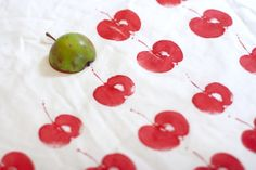 Printing with an apple- creating a gorgeously simple repeat pattern in happy bright red.