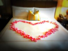 Rose petals on your Four Seasons bed = the ultimate romantic #fsdatenight. #ignitethespark