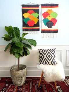 These fabulous wall hangings will be a bright addition to your space. They are in fabulous condition. Colors: black, yellow, green, orange, red, blue