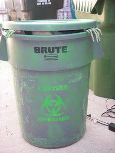 Creepy glowing skeleton that rises out of a biohazard barrel