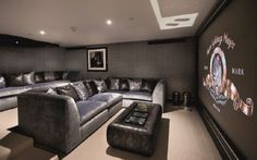 top-of-the range cinema with comfy velvet sofas, positioned at different levels to stop the 3.5 metre-high screen being blocked.