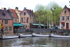 Boats on the canal in Brugge. #Brugge #Bruges #Belgium #Canal #Reflection #WaterReflection #Traveling #Travel #Europe #Flemish #Worldtraveler #Boats