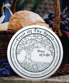 Seneca Ceramics Tree of Life Bread Warmer.  This handcrafted bread warmer is made by Seneca Ceramics in their pottery in upstate New York.  Simply warm it up in your oven or microwave and place it in the bottom of your bread basket and it will keep your bread warm all through dinner.