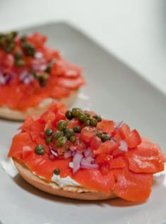 One of my all-time favorite meals/snacks.  Lox, bagels, cream cheese, tomato, red onion, & capers.  Mmmm.
