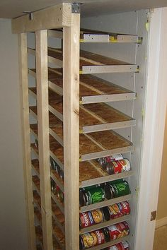 small canned food storage rotation shelf what a great idea! #storage #DIY #kitchen #pantry #handyman #home_improvement