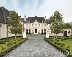 Step inside a stylish French neoclassical dwelling with an ornate limestone façade and steeply pitched slate roof.