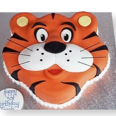 The Cake Store - Tiger Face Cake, £91.00 (http://www.thecakestore.co.uk/tiger-face-cake/)