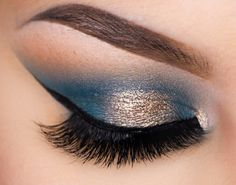 MUG eye shadows in Shark Bait, Peacock and foiled afterglow.  Pretty blue look!