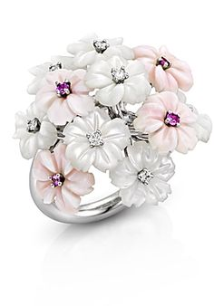 An 18k white gold bouquet ring, set with white and pink mother-of-pearl flowers, adorned with diamonds and pink sapphires.