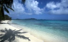 St.Vincent and the Grenadines for pristine beaches and idyllic rain forests.