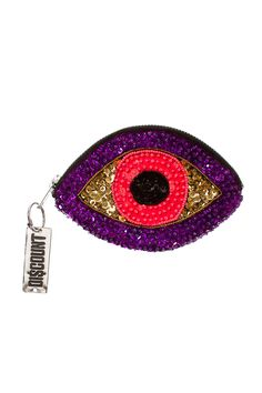 "DISCOUNT UNIVERSE PURPLE MINI SEQUIN EYE WALLET Purple, pink and gold mini wallet with sequin and bead embellishments, featuring top zip closure and custom logo zipper pull. Made in Australia. 100% cotton. SIZE & FIT One size.  6"" (15cm) across 3 3/4""(9.5cm) high  DISCOUNT UNIVERSE Discount Universe is a Melbourne-based label from Aussie duo Cami James and Nadia Napreychikov. Their bright, hand-embellished pieces that pack a punch with sequins, gems, and cartoon-like graphics have won them…"