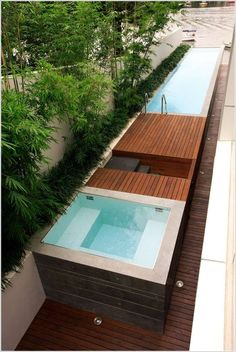 Swimming Pool Pumps for Above Ground Pools Inspiration of Modern Pool Using Above Ground Pool Border Planting Coastal Concrete Deck Geometric Geometry Hot Tub Jacuzzi Lap Pool Linear Outdoor Lighting Planter Side Yard Spa Uplighting View Waterfront