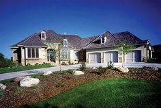 This spacious 4 bedroom home is packed with luxurious amenities.  House Plan # 481031.