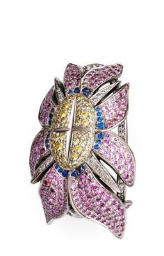 Otto Jakob, Caretas earrings, inspired by Alpine aster flower, diamonds and coloured sapphires,  2012